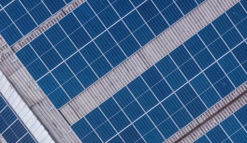 Web banner for commercial solar PV page: panels on roof