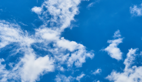 image of blue sky and small clouds