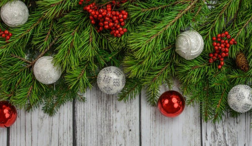 christmas tree and baulbes on wooden background
